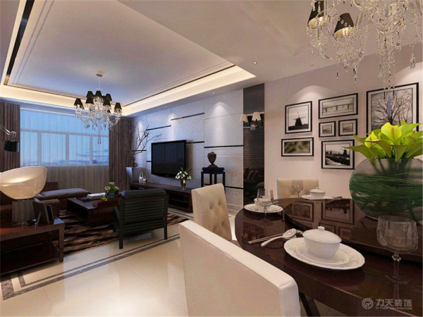 客厅的沙发采用了比较随意的懒人沙发,舒服而且实用,体现了美式家具那种随兴的搭配和极具实用性。电视墙采用了现代的装修风格用错落、反射较强的材料做装饰。