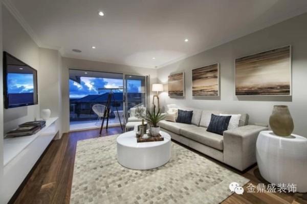 【别墅客厅装修效果图】小客厅的设计延续现代简约风格的特色,以白色、浅灰、灰黑色为主,有种素净之美。墙壁挂画用色偏暖,有种温馨感。地毯的设计很别致,编织感的纹理颇具时尚感。