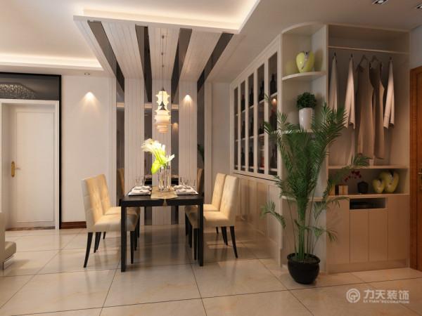 餐厅的灯光很重要既不能太强又不能太弱,灯光则以温馨和暖的黄色为基调,顶部做了混油处理木条与不锈钢简单间接搭配吊顶。