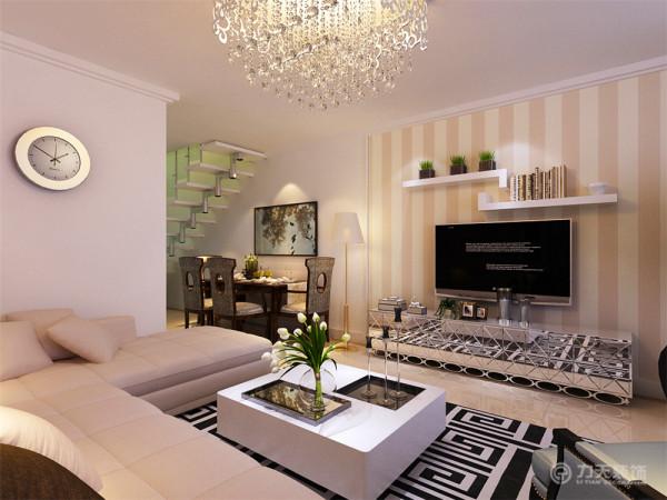 电视背景墙,采用挡板柜和壁纸的形式,给人温馨,时尚,大气的现代感觉。通过沙发背景墙等装饰,使整个家庭色调精彩。沙发墙运用挂画装饰的表现形式,更加彰显业主的品味与内涵