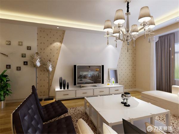 客厅的电视背景墙是以石膏板和壁纸做了一个简单而又美观的造型,凹凸有致,立体感较强,墙体是以浅咖色乳胶漆为整体,电视柜是以白色烤漆组成。