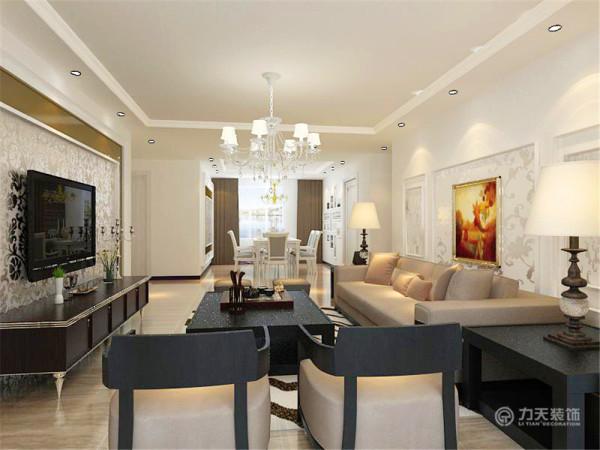 沙发背景墙也是反光壁纸和石膏线的组合,石膏线圈边里面是反光壁纸,外面是乳胶漆,沙发采用的是咖色的布艺沙发,茶几与电视柜一样是黑色的