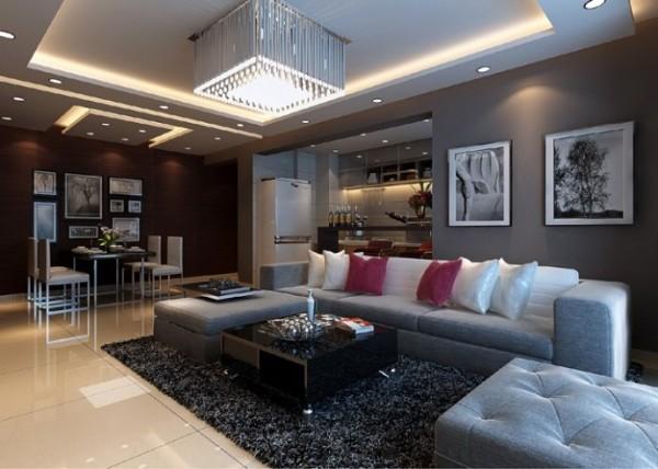 稳重大方的现代简约,时尚的灰色沙发与电视背景墙相呼应,电视背景墙的造型,既简洁又大方,再加上灰色,配上顶部照下来的灯光,整个电视背景墙把客厅格调给提升了起来.