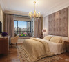 卧室的飘窗台为柜体设计,具有储物功能,飘窗顶整体采用生态木,营造出一个舒适安逸的休闲阅读区域。室内家具的搭配都为比较简洁的款式,与硬装的整体简洁相适应。