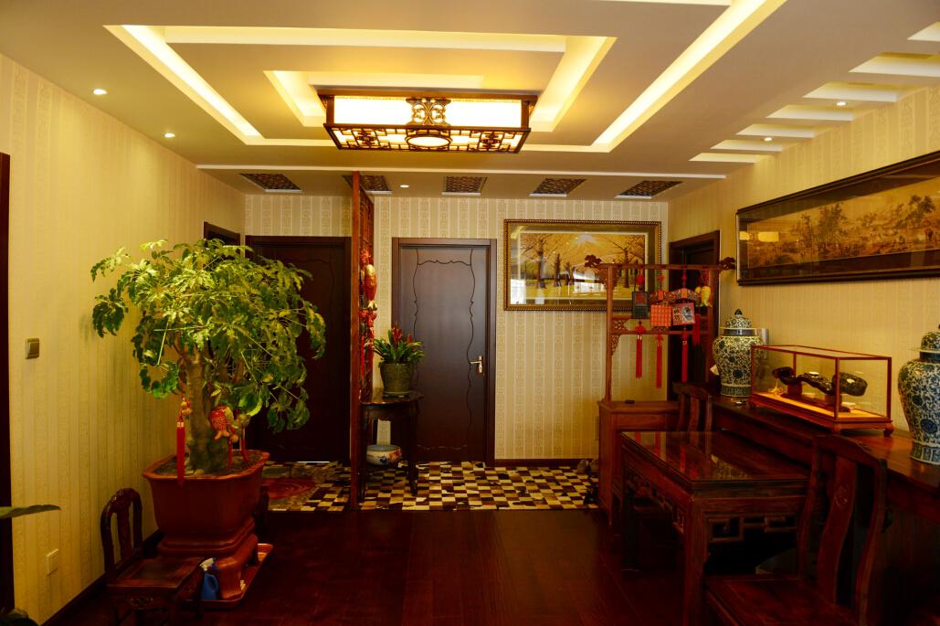 中式 三居 白领 旧房改造 今朝装饰 玄关图片来自北京老房装修-今朝装饰王丽在古色古香的中式设计的分享