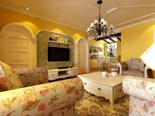 沙发选用了碎的花纹布,提升空间自然色彩,客厅电视背景墙采用马蹄形造型分为三个垛子,中间运用混油圈线做的造型,美观大方。