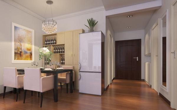 餐厅以白色为主调,搭配黑色玻璃餐桌,结合木色的餐边酒柜营造舒适优雅的用餐环境。铁艺水晶吊灯使整个用餐环境变得安静唯美。