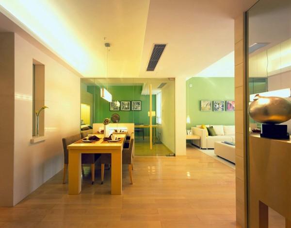 客厅和餐厅以造型独特而分开,造型的设计实行了功能的划分,很是富有层次感,整个方案的设计很具有个性化,用色大胆但是不显突兀。玻璃的隔断更具有通透性。