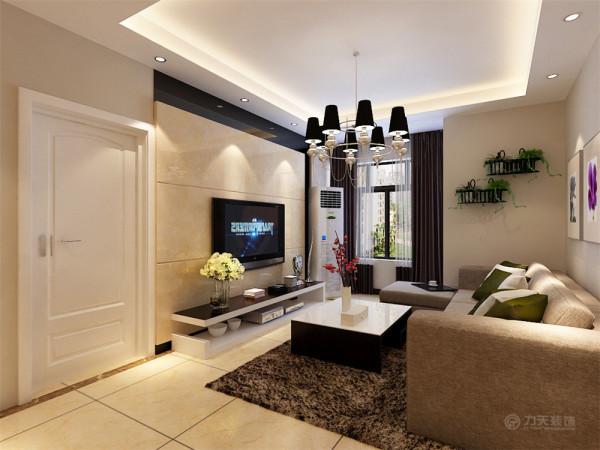客厅的电视背景墙是以大理石和黑镜做了一个简单而又美观的造型,凹凸有致,立体感较强,墙体是以浅咖色乳胶漆为整体,电视柜是以白色烤漆台面是以黑漆组成。