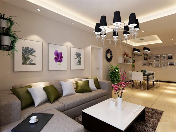 沙发背景墙是以画为主,整个空间的软装都是以白、咖色为主,客餐厅吊顶则是简单的回字形吊顶,彰显了极简主义的特点。玄关这一块就是以色彩对比较强的装饰画来简单的装饰了一下。