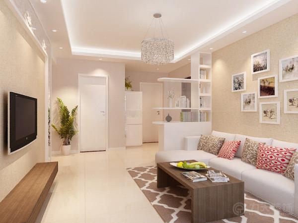 入户的玄关处设置了一个玄关柜,它兼具了鞋柜,储物、展示的空能。玄关柜的设置可以避免进门直接看到客厅,从入户到客厅有一个过度,客厅也获得一定的私密性,在人的心理上会有稳定感。