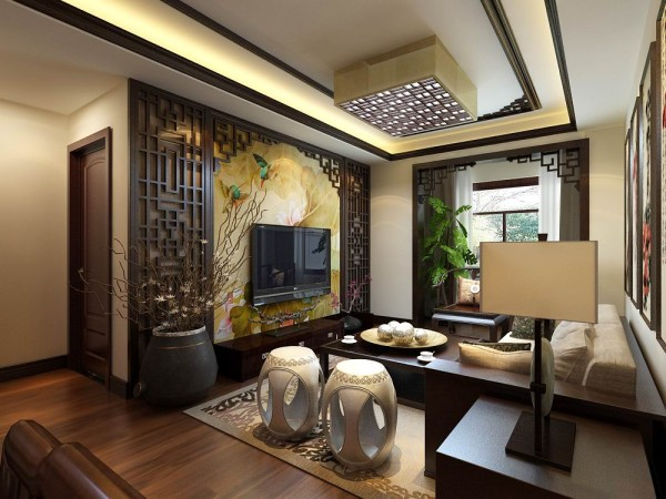 客厅回型吊顶,和凹槽灯带,以及房顶中式木线的装饰,影视墙局布采用石膏线加中式挂画,贴白砖的造型,中间放经典的筒灯,来突出中式影视墙风格的感觉