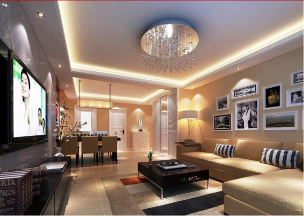 客厅是一个连接内外沟通感情的主要场所,是最能体现业主生活品味和情调的地方,设计通过颜色的整体搭配和独特的造型突出现代简约的风格。