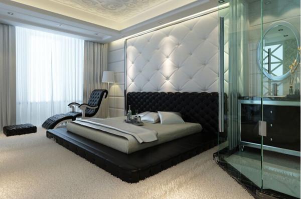 卧室背景墙用白色的菱形软包做装饰,与一旁的黑色菱形图案的榻榻米做一个鲜明的对比。