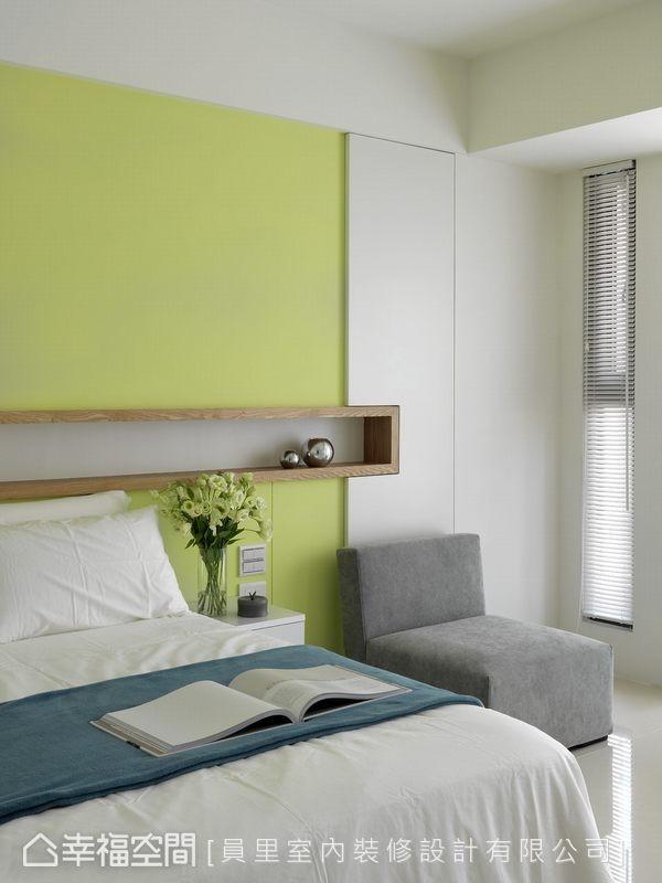 青苹果绿的立面选色,搭配木质框架与白色收纳柜的利落造型,营造活泼清新的空间感受。