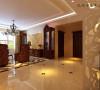 地面瓷砖拼花的设计让地面空间更加丰富,棚面吊顶为直线吊顶,这种吊顶的好处是可以增加空间感,内置多个筒灯,满足不同的光线需求,中间为实用的水晶吊灯给人以高贵温馨的感觉