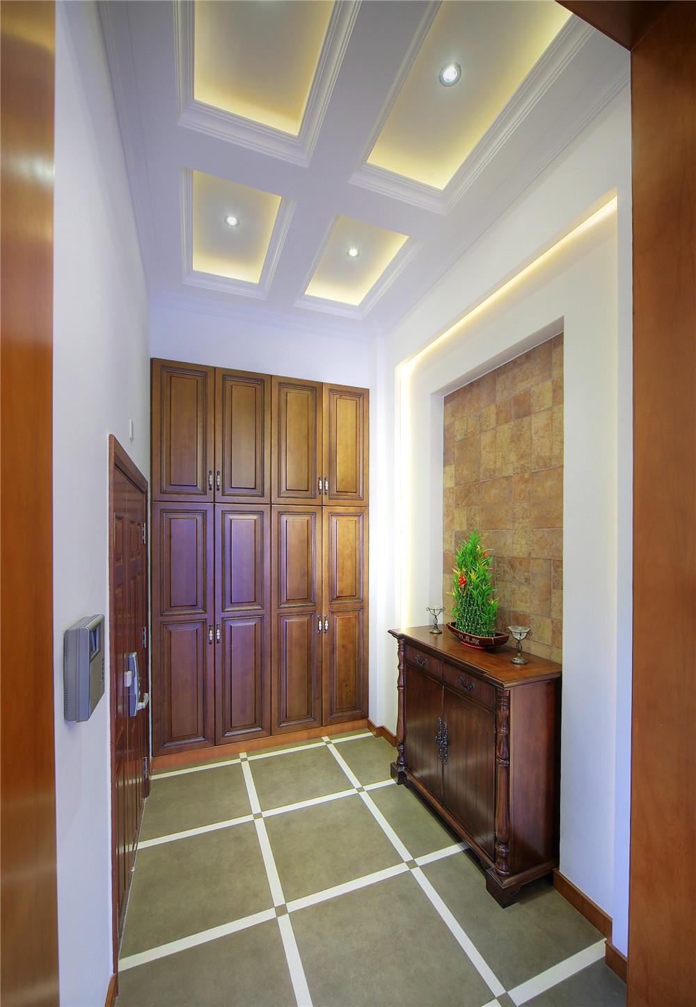 别墅 别墅装修 别墅设计 聚通装璜 欧美风格 玄关图片来自jtong0002在上海环球翡翠湾别墅装修实景展示的分享
