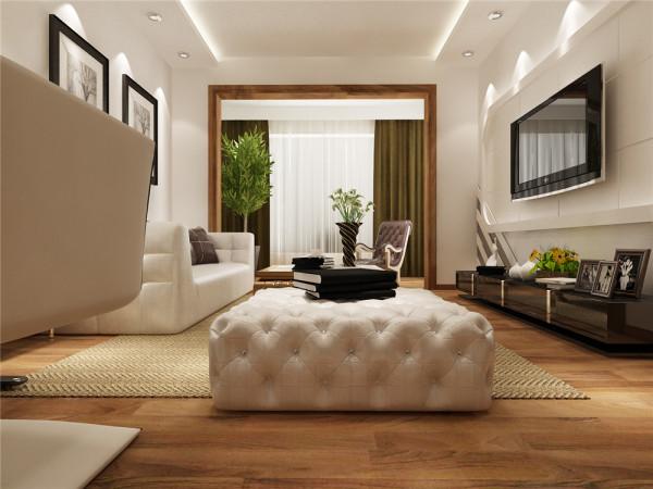 该户型客厅地板采用瑞士卢森地板,既大气又容易清洗,优点是,耐磨并可供地暖 使用,而且地板地面会在视觉上夸大客厅面积,使本来不大的空间得到延伸和扩展。