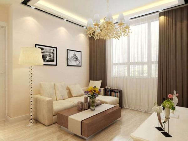 沙发背景墙是两幅富有现代气息的装饰画,餐厅整体色调与客厅相对应,厨房布置成了开放式厨房,使空间感增强;
