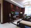 白色的床面增加 整洁之感,一组中式的衣柜利于储物。影视墙很是漂亮,采用地板上墙, 加烤漆玻璃装饰。灰色的电视柜增加亮点。地面采用的木地板,它的好处 在于脚感好,同事又烘托出中式特点。