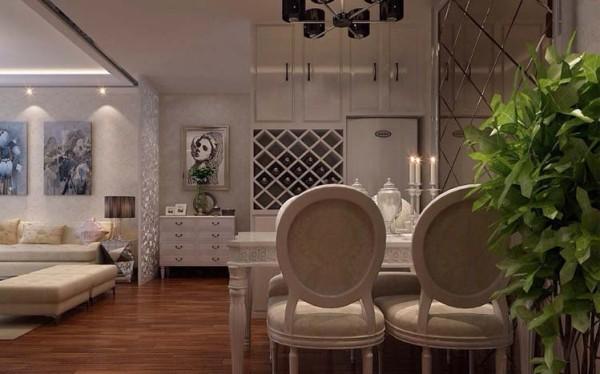 设计理念:餐厅使家庭成员品尝佳肴、接待亲朋好友的场所,需要营造轻松愉快、亲密无间的就餐气氛。 顶部与墙面的菱形玻璃相互辉映,映衬出菜肴的色彩,增添了食欲。