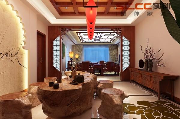 客厅:传统风格造型的灯箱与深色木角线的结合,多了几许惬意和灵动。色彩明丽的装饰品和绿植的运用,减轻了庄重压抑之感,更具有活力。 电视背景墙的线条精致而考究,与顶面造型形成极好的呼应。