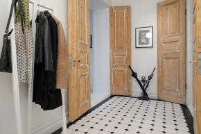 北欧 三居 白领 收纳 80后 小资 玄关图片来自沪上名家装饰在118平--经典北欧公寓的分享