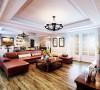 明亮的白色和鲜艳的酒红色组成了客厅的色调基础,搭配褐色、银蓝等色块,整个空间的色调主次分明而形象饱满。简化的线条,进一步提升了空间的明朗与流畅感。