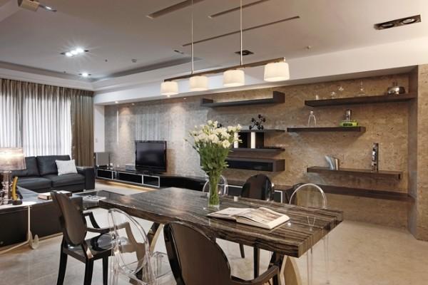 现代简约风格:鉴于居家成员单纯,却需有三代同堂、各自独立使用的生活空间,设计师由厨房区延伸出一座大型中岛吧台,让所有家庭成员能在这一起共享生活的重要区域