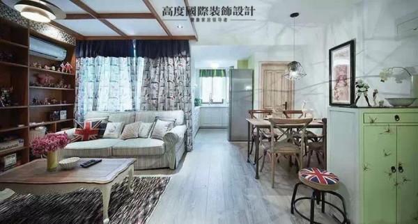 厨房间也是开放的模式,整体的客厅和餐厅的采光都是非常明媚的。进门的鞋柜自然的绿色进门给人一种清新的感觉。