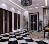 电梯厅简单方便,黑色的镂空装饰分隔了电梯与电梯间的空间,精心搭配选择的镂空式灯具,体现了内敛、质朴的风格,光线柔和、色调温馨给人宁静的感觉;小幅的山水画,丰富别墅空间设计的生命力,突显业主的品味。