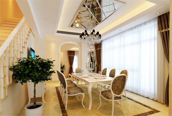 餐厅之间设计了白色雕花装饰隔断,拱形的门及哑口是欧式元素的体现。电视背景墙凹凸造型更家有层次感,两侧的斜铺银镜使得空间更明亮更宽敞。饰品的搭配显示出自主人的富足和品位。