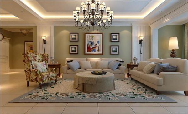沙发背景墙设计: 将对称、大气等元素发挥极致,也用石膏线条做出了对称的边框造型,电视墙上的写意壁画,质感的装饰品等元素,使得这个空间更具豪华质感。