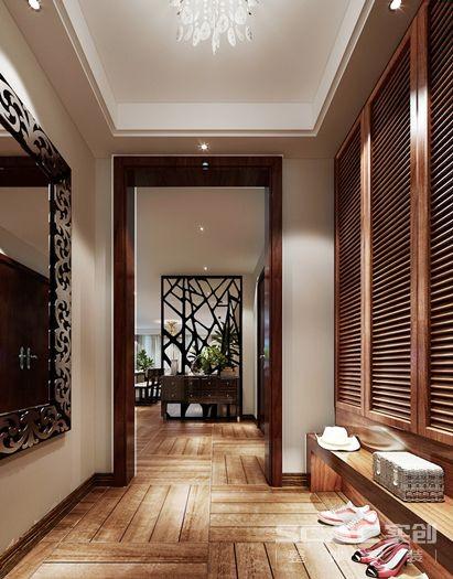 门厅主材: 入户门处入眼的是装饰一面像镶嵌镂空的隔断,既遮挡了后面的就餐区直对门口的风水大忌,又饶有特色的使进门的客人眼前一亮,此处为设计之亮点。