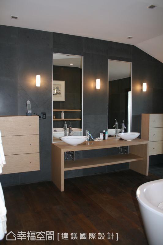 采用干湿分离设计,透过浅色木纹层板,墙壁使用台湾观音石材,铺贴深色木纹地坪,都在在呼应餐厨区的设计。