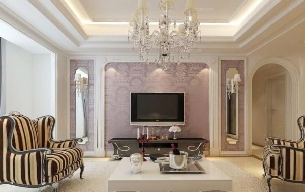 电视背景墙主要运用了石膏线、壁纸和镜面的搭配。让客厅更显得宽敞明亮。