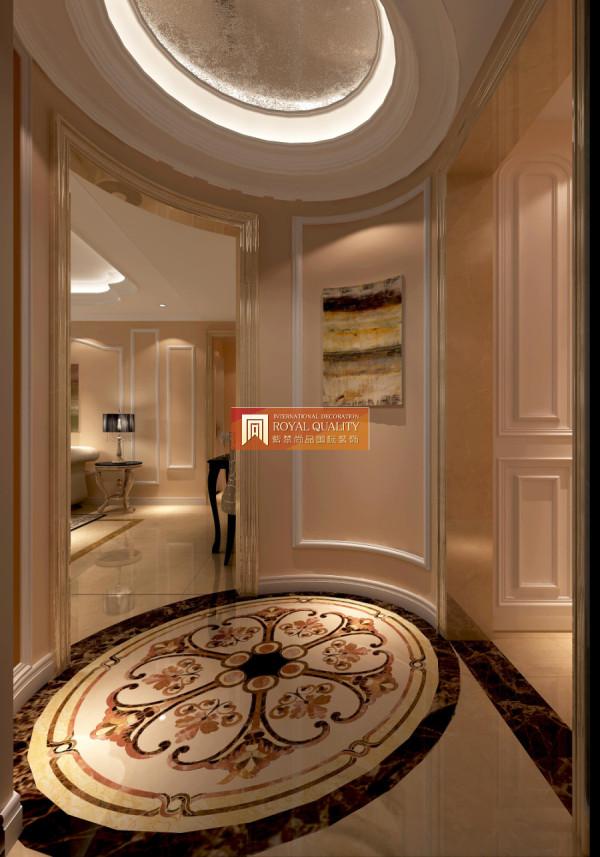 门厅装修:圆弧形的拼花地砖,简单的装修画,让整个空间恢弘大气