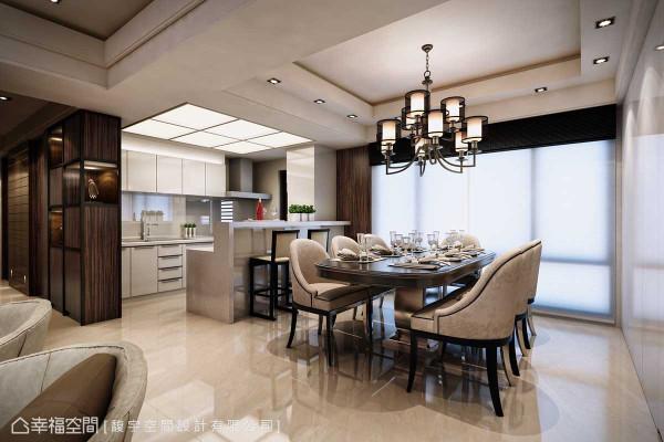 将原本厨房的封闭格局改以开放的开阔型态,白色柱体实为冰箱的藏身之所,吧台则结合了餐厨机能。