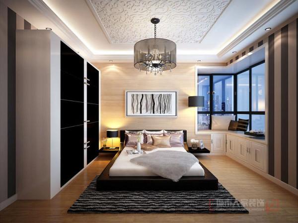 很好的延续了整体简约利落的风格,内嵌式衣柜的设计即美观又扩大了整体空间,整体色调的搭配则更好的中和了单调感。