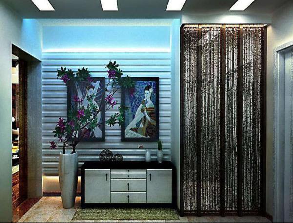 入户门的冷光效果与之客厅的暖光效果形成一个对比,让居者享受其景