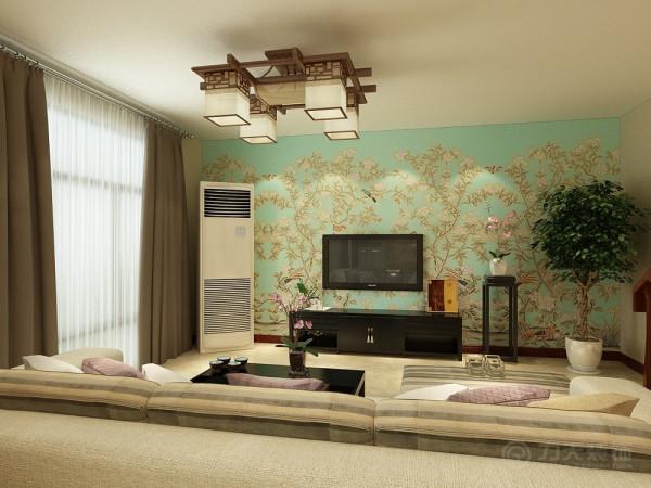 本次的设计风格是新中式。客厅没有吊顶电视背景墙贴了一个比较中式的蓝色壁纸,客厅用了深色的电视柜、茶几但是又不能显得客厅太沉重,所以沙发选择了浅色的。