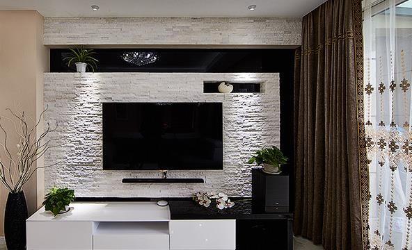 客厅背景墙,文化石与黑色屏搭配,给人大气时尚感。