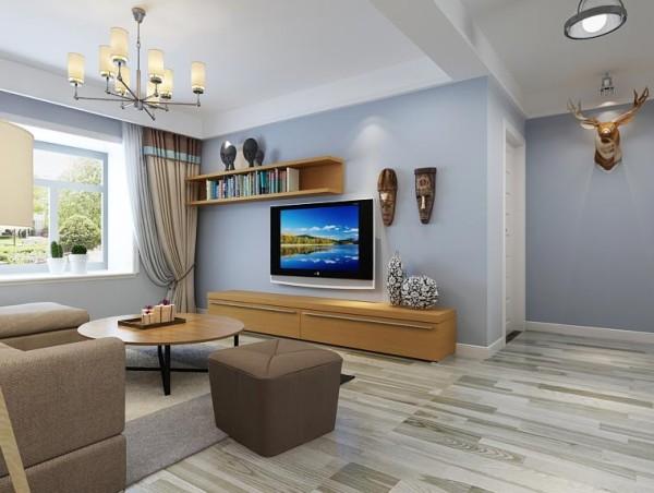 客厅整体采用淡蓝色装修设计,地面采用淡蓝色岩石纹理地板进行装饰,整个房子的墙面粉刷淡蓝色的墙漆,顶面为白色。配色非常的简洁大方。