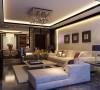 客厅大气稳重,简洁的现代造型,配合古朴的木饰面的点缀,体现出主人的品味。墙面部分采用石材,提升整个空间的档次。