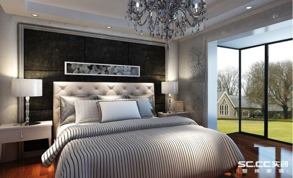 深灰色的床头背景,以硬包的形式体现,延伸了客餐厅的风格定向,也展现了主人的沉稳。