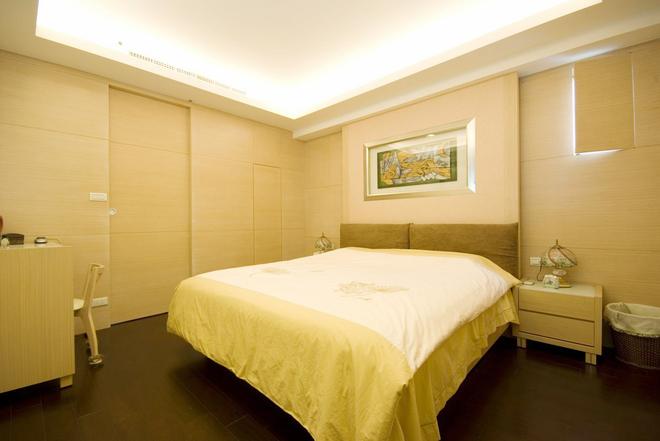 三居 简约 卧室图片来自四川岚庭装饰工程有限公司在115平米堆迭有层次的三居空间的分享