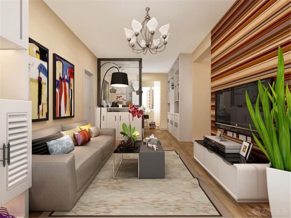 客厅这里因为空间的局限性,所以只放置了一个小型的三人沙发,茶几也选的小号的,电视背景墙采用了贴壁纸,整体的墙面是米黄色的,所以电视背景墙贴的是棕色的横条纹壁纸;
