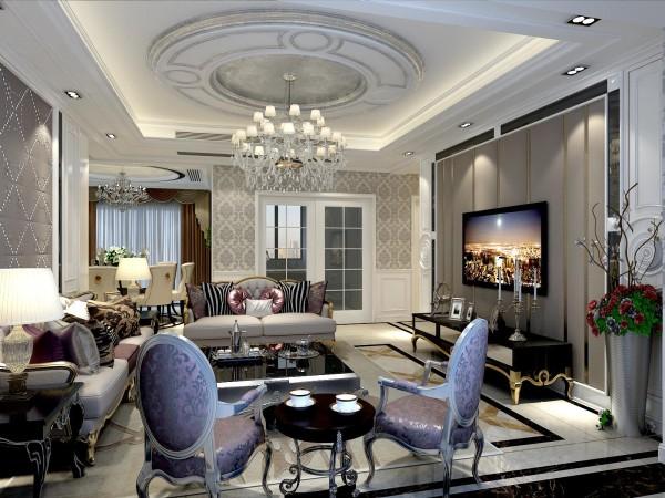 客厅护墙板上嵌入玫瑰金不锈钢线条和镜面框使空间更具色彩感,采用装饰主义雕花和软包,圆形吊顶上镶嵌有银泊更加突出奢华感和空间的层次感