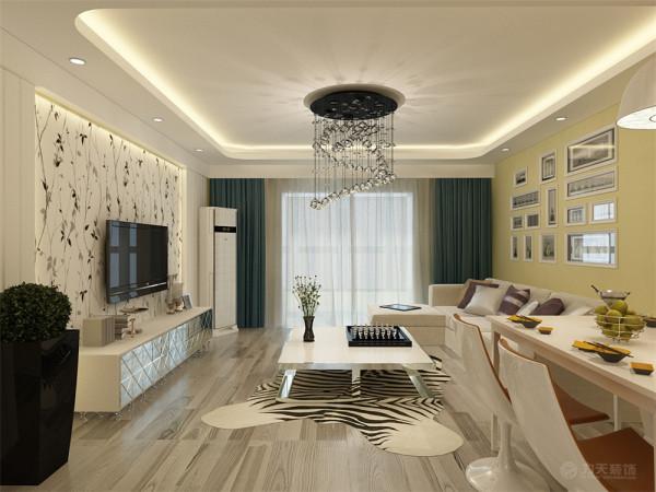 客厅与餐厅是整个在一个空间的格局。厨房是半开方式厨房,增加区域与彩光;客厅运用了圆角回字形加筒灯加灯带的造型设计。配以筒灯的装饰,更加明确的在吊顶上区分了客厅与餐厅的空间。