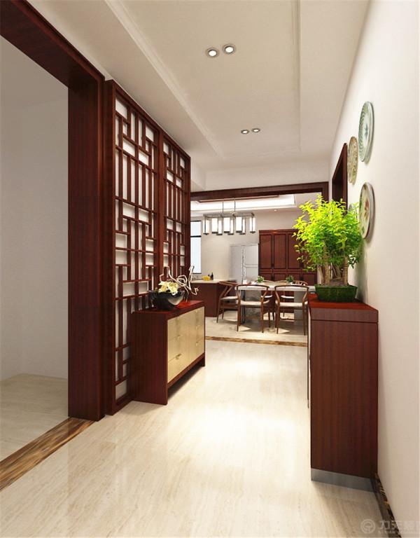 在入户出设计一个玄关柜作为空间的重点,让空间有一个内外的过度。入户门的一侧安置一个入户鞋柜。